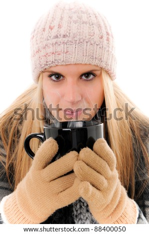 Winter Woman holding a hot beverage with mittens on
