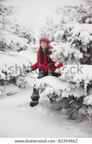 winter woman play snowballs