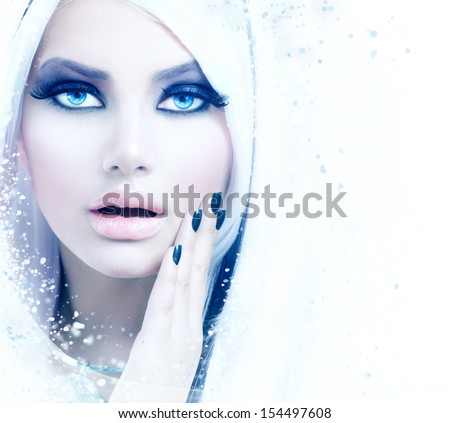 Stock Photo Winter Woman Portrait. Snow. Beauty Fashion Model Girl with White Hair and Blue Eyes closeup. Make up. Smoky Eyes. Isolated on a White Background