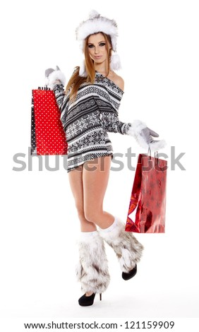 Winter woman with shopping bags over white