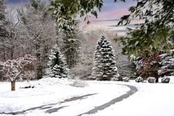 Winter wonderland in New England. Tranquil and beautiful late afternoon wintery scene in Littleton, Massachusetts.