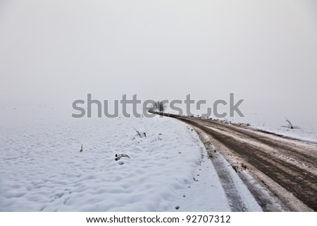 Winterly road in germany - stock photo