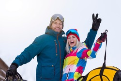 Wintersport Activities. Lovely Caucasian Couple Having Tube Activities In Winter Time And Posing Together In Mountains. Horizontal Image