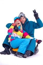 Wintersport Activities. Lovely Caucasian Couple Having Tube Activities In Winter Time And Posing Together And Laughing Outdoor. Vertical Image
