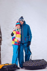Wintersport Activities. Lovely Caucasian Couple Having Tube Activities In Winter Time And Posing Together In Mountains. Vertical Image