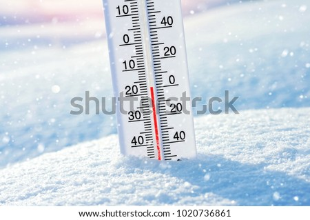 Wintertime. Winter background with  thermometer in the snow on frosty day. #1020736861