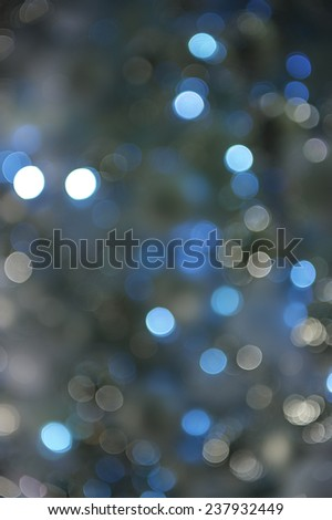 Wintry blue holiday Christmas lights background in bokeh bubbles