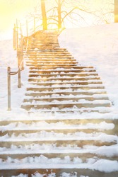 wintry hill with wooden staircase, steps with snow covered, into the light. shiny hopeful scenery, sympathy design
