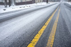 wintry mix and snow on a county road in winter