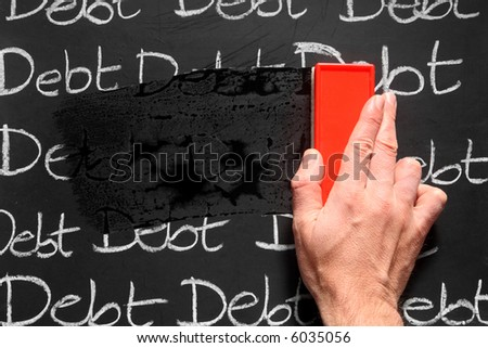 Wiping debts away. - stock photo