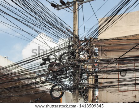 Wire and cable clutter, The chaos of cables and wires on every street in Bangkok, Thailand. #1413509345