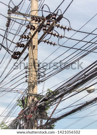 Wire and cable clutter, The chaos of cables and wires on every street in Bangkok, Thailand. #1421056502