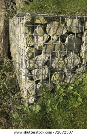 Wire and stone gabion retainer.