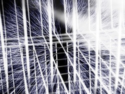 Wire background with smoke starting to flow between wires. Focus is in the middle of the space. Illustration of faraday cage with bolts touching the cage