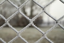 wire fence texture with hoarfrost overlay