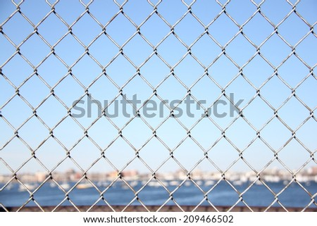 Wire Fence with Harbor in Background