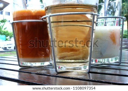 wire frame containing Thai market street style breakfast with orange colour Thai  tea with condensed milk, Chinese tea and soft boiled eggs #1108097354