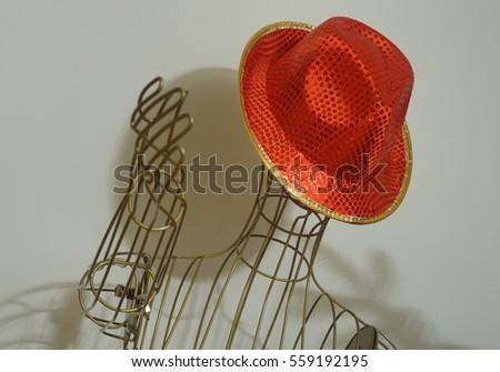 Wire frame mannequin with flashy red hat #559192195