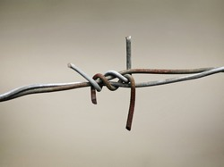 wire knot on metal fence