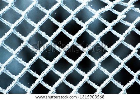Wire mesh covered with frost frosted to frost. #1315903568