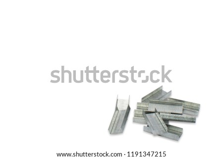 wire stapler pin on white background.