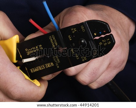 wire stripper   in the hands of worker