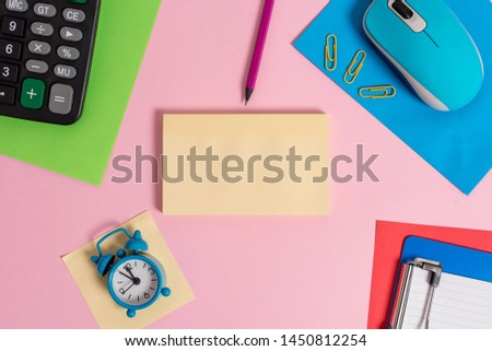 Wire vintage electronic mouse hardware gadget two blank paper sheets clips notepads calculator colored background empty text important events home office school everyday