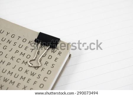 Wirebound notebook with black paper clip