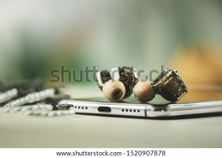 Wired earphones for smartphone and other player. Selective focus on earphone.