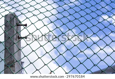 Wired fence cage on a sky background #297670184