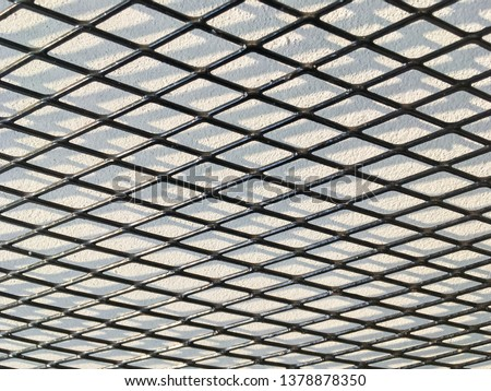 Wired fence in shadow pattern on white wall background diamond-shaped grid, grid background. #1378878350