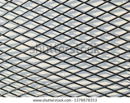 Wired fence in shadow pattern on white wall background diamond-shaped grid, grid background. #1378878353