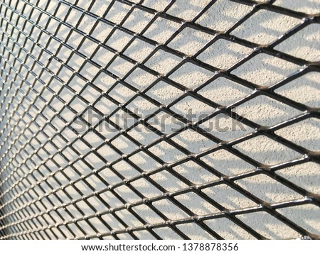 Wired fence in shadow pattern on white wall background diamond-shaped grid, grid background. #1378878356