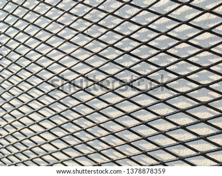 Wired fence in shadow pattern on white wall background diamond-shaped grid, grid background. #1378878359