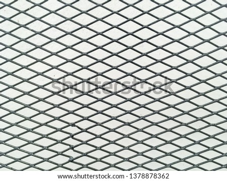 Wired fence in shadow pattern on white wall background diamond-shaped grid, grid background. #1378878362