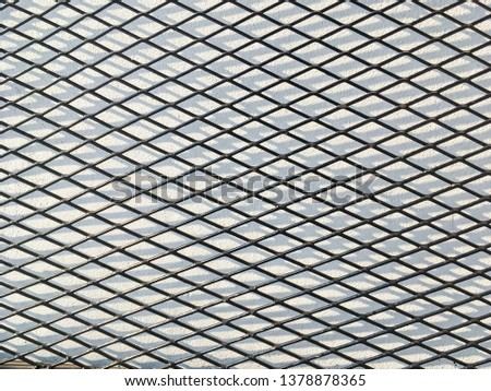 Wired fence in shadow pattern on white wall background diamond-shaped grid, grid background. #1378878365