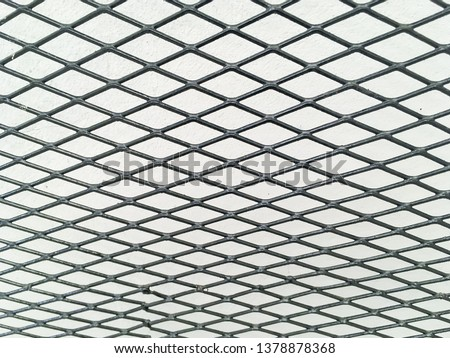 Wired fence in shadow pattern on white wall background diamond-shaped grid, grid background. #1378878368