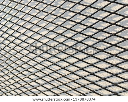 Wired fence in shadow pattern on white wall background diamond-shaped grid, grid background. #1378878374