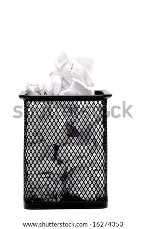 wired metal bin filled with crumpled paper, against white background