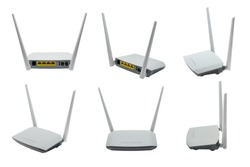 Wireless ADSL router and modem, wifi router and switch, combined device for modulation and demodulation. Network ports LAN and DSL. Isolated, white background.
