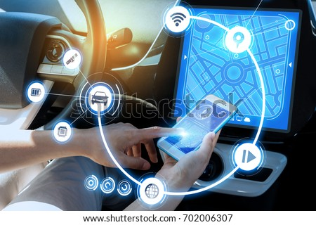 wireless communication between smart phone and car instrument panel. autonomous car. #702006307