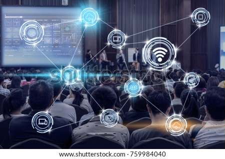 Wireless communication connecting of smart city Internet of Things Technology over Abstract blurred photo of conference hall or seminar room with attendee background, technology with education concept