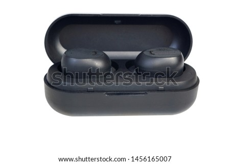 Wireless earphones.wireless headphones in the case of charging isolated on white background #1456165007