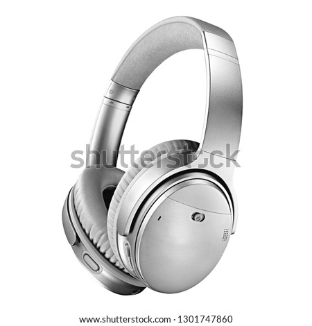 Wireless Headphones Isolated on White Background. Side View of Silver Color Stereo Headset With Inline Mic Integrated Microphone. Advanced Acoustic Stereo Sound System #1301747860