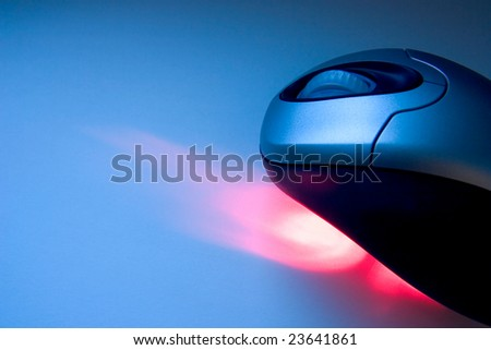 Wireless mouse with red laser in a tech backround