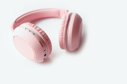 Wireless Pink Headphones, isolated in white background, use for listening music and watch movies or exercise, earphones good item for work from home mode. Relaxing time with melody and music sound.