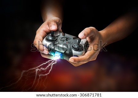 Wireless transmitter remote controller in hand for playing computer game or toy control