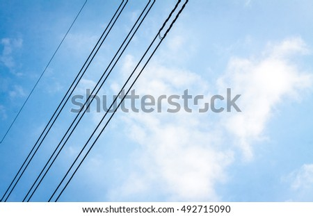 wires pole with blue sky. electrical wires on a background. electric cables. power cable with blue sky. Transmission Line cables. Electric wire in the sky backdrop. Electric wire isolated background. #492715090