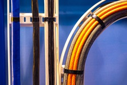 Wiring. Electric wires in the production. Electric wires of different colors. Cables of various types in the enterprise. High power loads. Wires are fastened with a hammut. Structured power networks