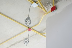 Wiring work for electrical system under concrete floor at construction site